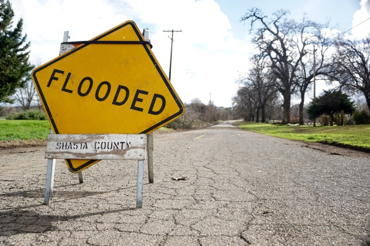 Flooding rivers have plagued roadways and communities over the last week in Northern California. This photo shows the road in front of Gover Ranch struggling to keep dry as the waters of Battle Creek rise.