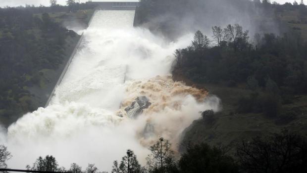APTOPIX Damaged Dam